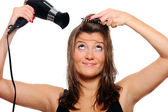 Young woman drying hair — Stock Photo