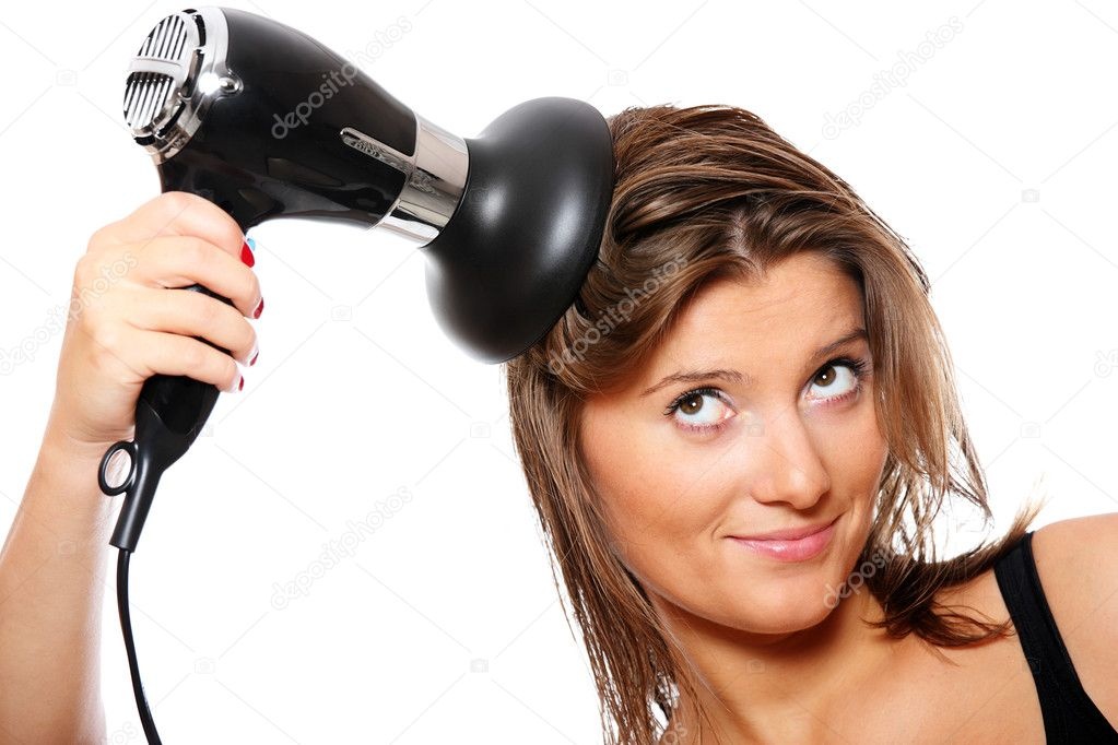 A close-up of young pretty woman and a big hair dryer white background — Stock Photo #4233608