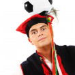 Polish man in a traditional outfit with football on head — Stock Photo