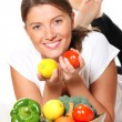 Young woman with vegetable basket — Stock Photo