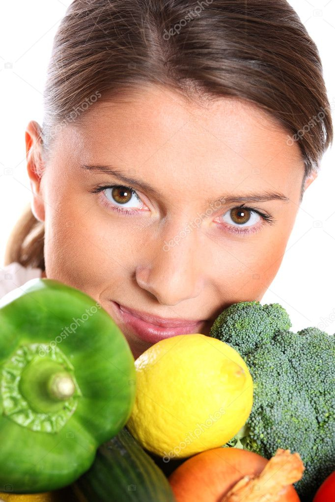 A close-up of a beautiful woman covered with vegetables over white background — Stock Photo #4290420