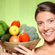 Young woman and vegetable basket — Stock Photo
