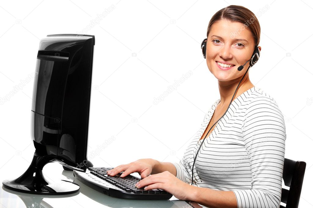 A portrait of a young pretty woman in the office with a headset over white background — Stock Photo #4317857
