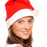 Beautiful girl in Santa's hat — Stock Photo