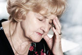 Senior lady with headache — Stock Photo