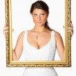 Bride with golden frame — Stock Photo