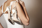 Bride with worn-out shoes — Stock Photo