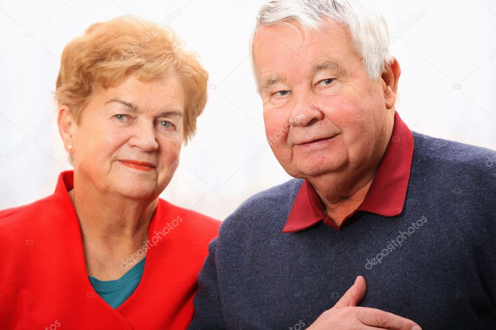 A nice portrait of a senior couple standing against white background — Stock Photo #4736051