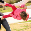 Two adults fighting for child — Stock Photo #4772338