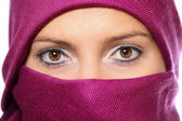 Muslim woman hidden behind a purple scarf — Stock Photo