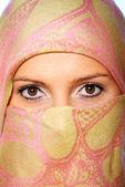 Muslim woman hidden behind a scarf — Stock Photo