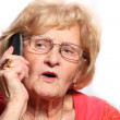 Elderly lady on the phone — Stock Photo #4905251