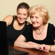 Senior lady on the computer — Stock Photo #4905304