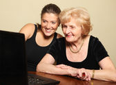 Senior lady on the computer — Stock Photo