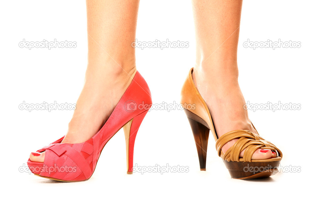 A picture of a woman standing against white background in two different shoes — Stock Photo #4911514