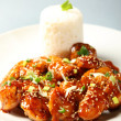 Stock Photo: Sesame chicken with rice