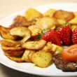 Beef steak with sliced potatoes - Stock Photo