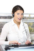 Beautiful woman in a call center — Stock Photo