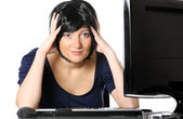 Frustrated woman at work — Stock Photo
