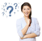 Young pretty woman with question marks — Stock Photo