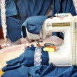 The sewing machine and fabric - Stock Photo