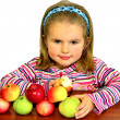 The beautiful child eats beautiful apples - Stock Photo