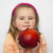 The beautiful girl holds a huge pomegranate in hands — Foto Stock