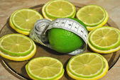 Lemon and лайм help to dump excess weight — Stock Photo