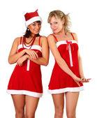 Duas belas mulheres em vestido de natal — Fotografia Stock
