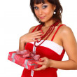Brunette girl in santdress holding present — Stock Photo #4339824