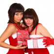 Two pretty brunette girls in santdress holding presents — Stock Photo #4339844