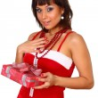 Brunette girl in santdress holding present — Stock Photo #4477333