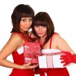 Two pretty brunette girls in santdress holding presents — Stock Photo #4477407