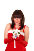 Ragazza bruna in abito di santa dando un giocattolo decorati come casa — Foto Stock