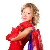 девушка в платье санта с мешками, делать покупки — Стоковое фото