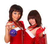 Two girls in santa dress with christmas decoration and bag — Stock Photo