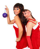 Two girls in santa dress with christmas decoration — Stock Photo