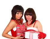 Two pretty brunette girls in santa dress holding presents — Stock Photo