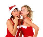 Girls in christmas santa dress whispering — Stock Photo