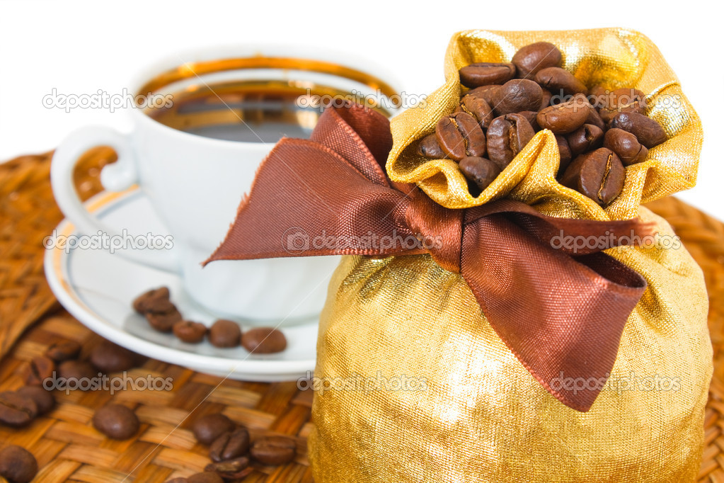 Coffee bean in gold bag and cup on basket — Stock Photo #4204526