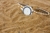 Hand watch in sand — Stock Photo