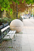 Stone ball and a bench — Stok fotoğraf