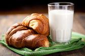 Croissants and milk — Stock Photo