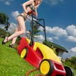 Dangerous lawn mowing - Stock Photo