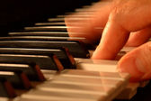Mans hands playing piano — Stock Photo