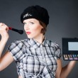 Young woman with makeup palette and brushes — Stock Photo