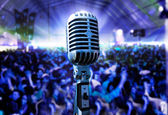 Vintage microphone and public — Stock Photo