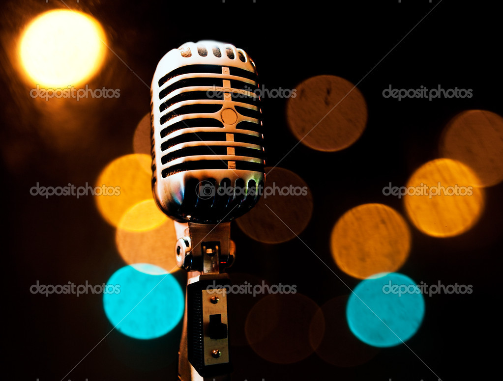 Musical background with microphone and stage lights — Stock Photo #5303467