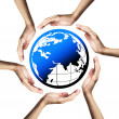 Blue planet (Earth) surrounded by hands — Stock Photo #3927494