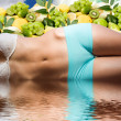 Woman body in water over fresh fruits and sunny sky — Stock Photo #3927766